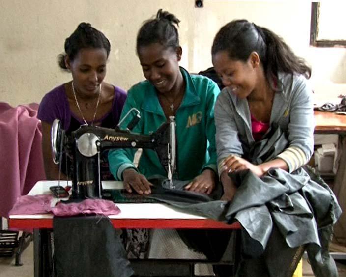 Three Girls Sewing