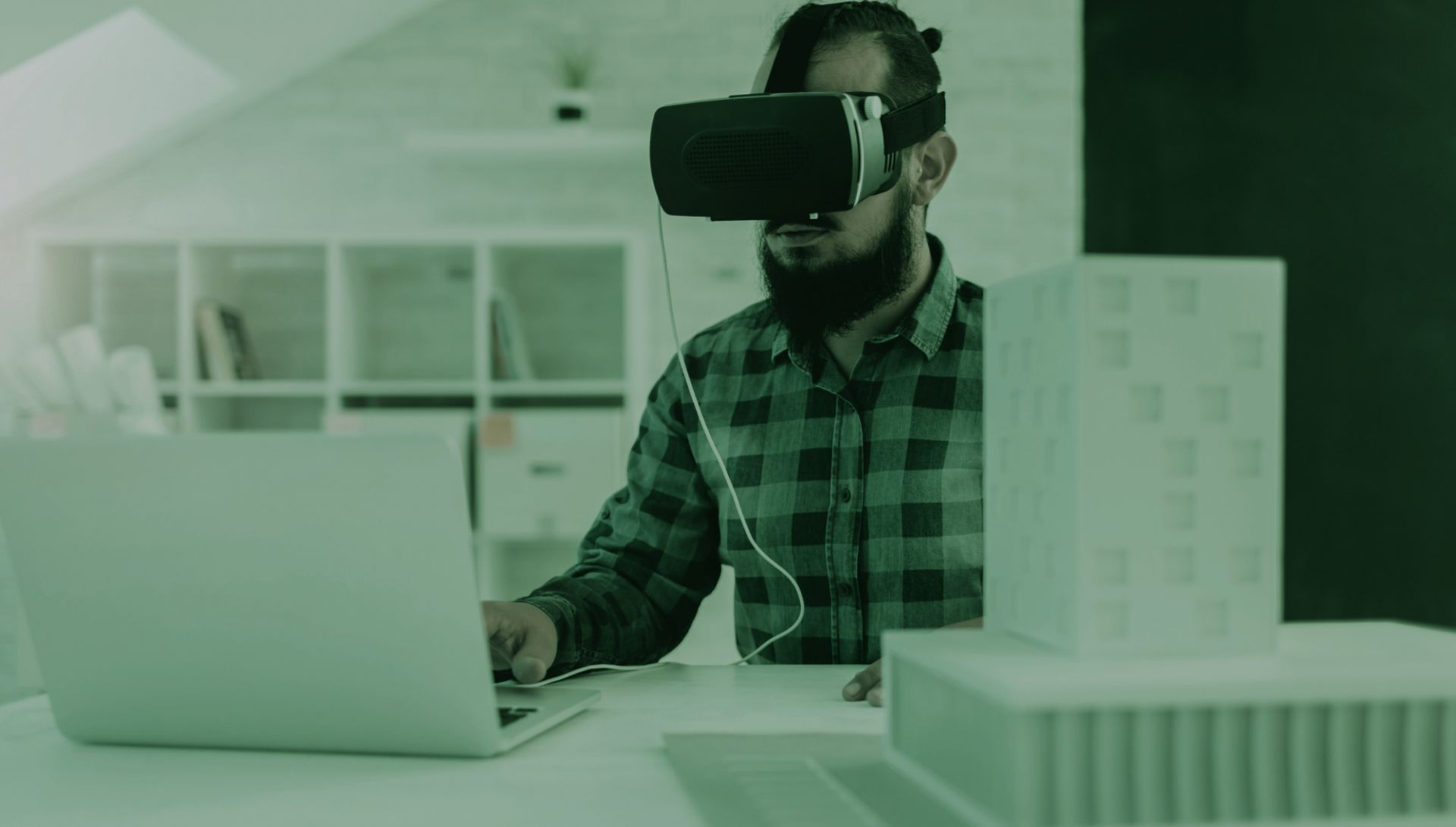 high tech industry image of engineer programming with VR goggles